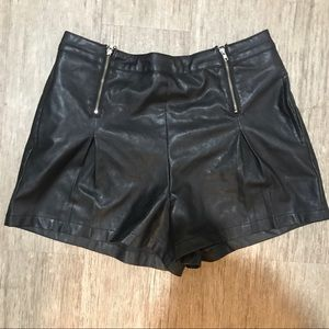 Black faux leather hot pants with double zips